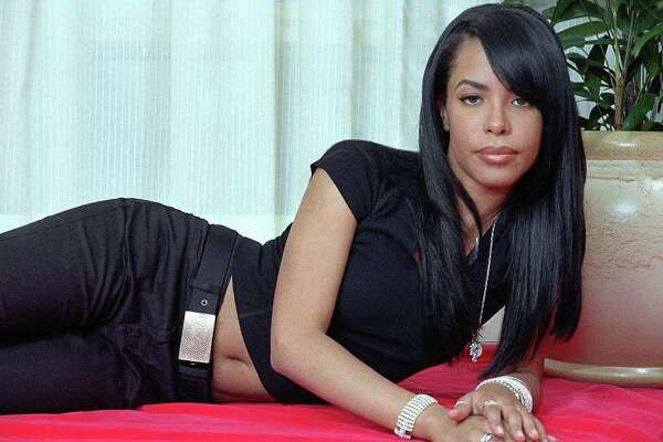 R&B singer and actress Aaliyah poses for a photo in New York on May 9, 2001. Aaliyah died Saturday, Aug. 25, 2001, when a small plane that was to carry her and eight others back to the United States crashed after takeoff in the Bahamas, authorities said.