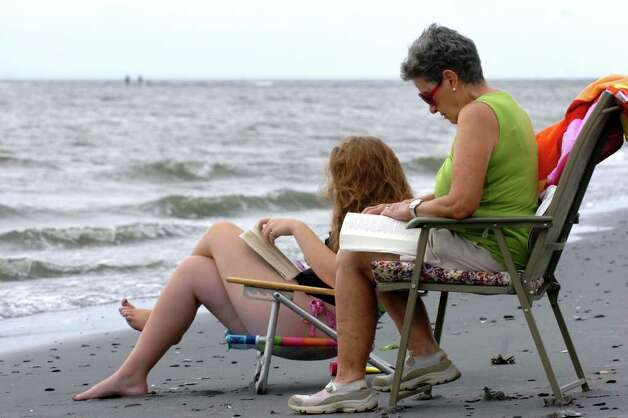 Joan Perugine and her granddaughter Katherine Drewry read on the beach near Silver Sands State park in Milford, Conn. Aug. 25th, 2011. Photo: Ned Gerard