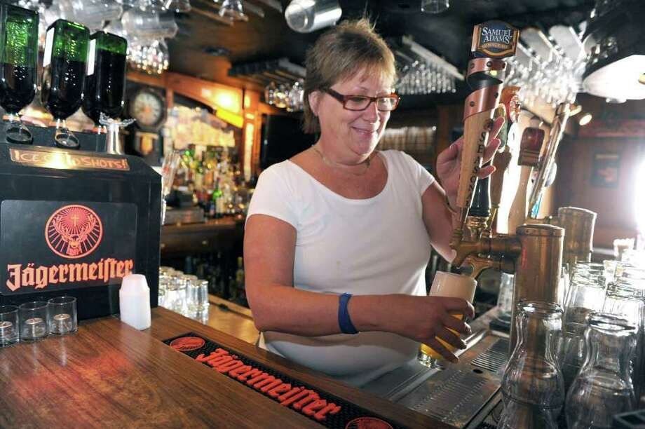 Nancy Silverman, owner of the Georgetown Saloon, pours a drink in the bar. Photo taken Friday, August 19, 2011. Photo: Carol Kaliff / Connecticut Post