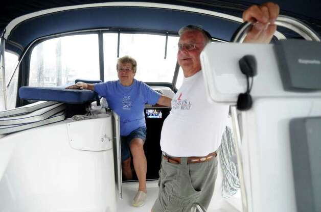 Janice and Frank Cook prepare for Hurricane Irene at Brewer's Yacht Haven in Stamford on Thursday, August 25, 2011. Photo: Lindsay Niegelberg / Stamford Advocate