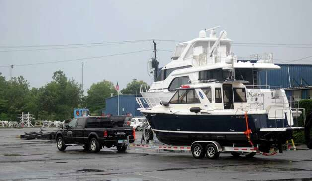 Boat owners prepare for Hurricane Irene at Brewer's Yacht Haven in Stamford on Thursday, August 25, 2011. Photo: Lindsay Niegelberg / Stamford Advocate