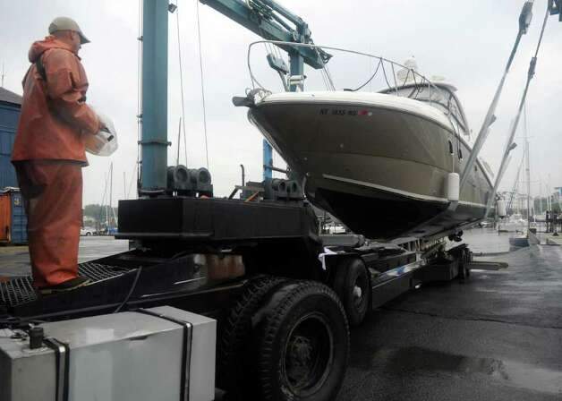Andrew Kenny, Yard Foreman at Brewer's Yacht Haven in Stamford, operates a marine travel lift and a hydraulic trailor to remove a boat from the water in preparation for Hurricane Irene on Thursday, August 25, 2011. Photo: Lindsay Niegelberg / Stamford Advocate