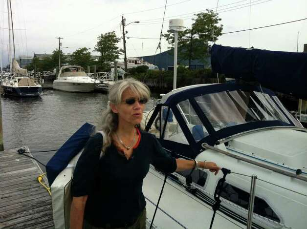 "Manhattan resident Hanne Nielson says she will ride out Hurricane Irene on her boat Misty Morn with her cat Vincent at Brewers Yacht Haven Marina West. Nielsen, who has been sailing all her life says she has doubled her dock lines and got out the ""big old"" bumpers in preparation for the hurricane. Photo: John Nickerson"