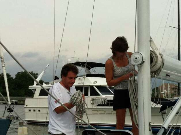 "Jay and Carolee Gravina coil lines as they prepare their 25-foot sailboat ""Faith"" for Hurricane Irene at Brewer's Yacht Haven Marina West. Photo: John Nickerson"