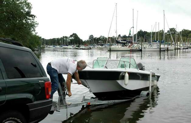 Trying to keep ahead of Hurricane Irene, Gary Florczak pull his boat out of South Benson Marina in Fairfield Conn.on Thursday Aug. 25, 2011. Florczak is going to put the boat in his yard until the storm passes this weekend. Photo: Cathy Zuraw / Connecticut Post