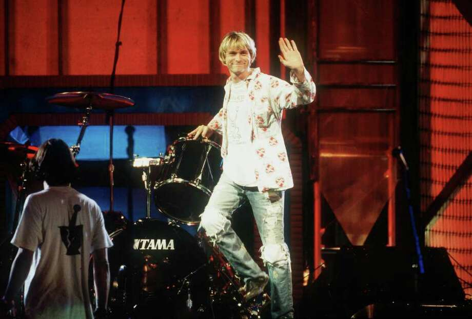 """1992: Though they had been expressly forbidden by VMA producers, Nirvana opened their 1992 performance with unreleased song """"Rape Me""""...and it wasn't caught by censors. Near the end of the performance, bassist Krist Novoselic threw his bass guitar in the air and attempted to catch it, only to have the guitar come crashing down on his head.  Photo: Frank Micelotta, Getty Images / Getty Images North America"""