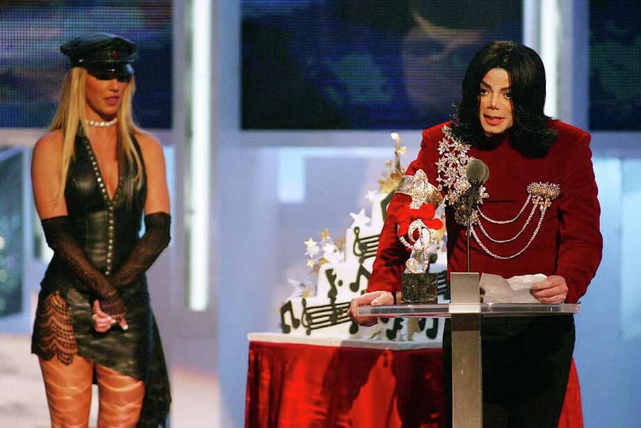 "2002: Britney Spears presented a birthday cake to the King of Pop, calling him her ""artist of the millenium."" MJ apparently thought he was receiving a non-existant Artist of the Millenium award and proceeded to give a thoroughly awkward acceptance speech.  Photo: Scott Gries, Getty Images / Getty Images North America"