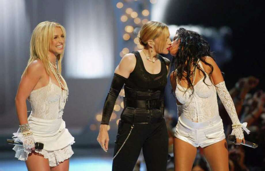 2003: After kissing Britney, Madonna turned to smooch Christina as well...although, nobody seems to remember that part.  Photo: Scott Gries, Getty Images / 2003 Getty Images