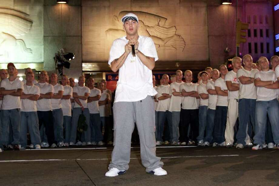 "2000: Eminem made waves with an army of clones, who appeared with him for a performance of ""The Real Slim Shady."" Photo: Frank Micelotta, Getty Images / 2004 Getty Images"