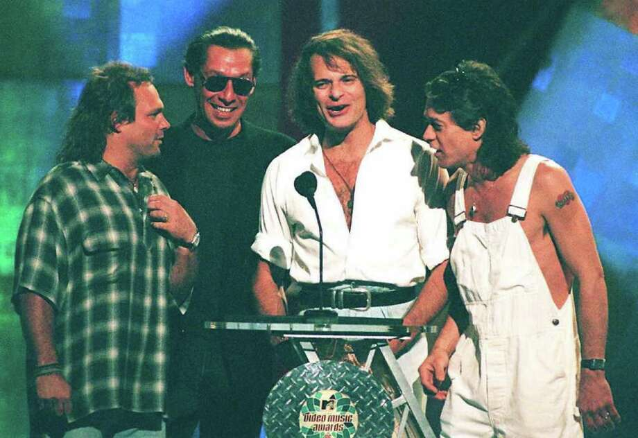 1996: Rock group Van Halen appeared together for the first time in 10 years, but the reunion was icy. After making strained jokes about each other on stage, David Lee Roth and Eddie Van Halen nearly got into a fistfight backstage.  Photo: DON EMMERT, AFP/Getty Images / AFP