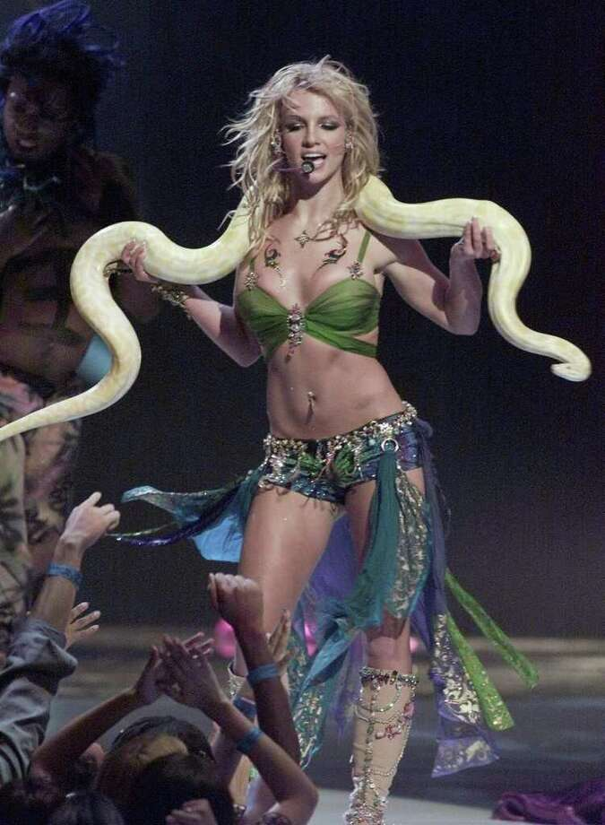 2001: Britney Spears rocked the stage with this instantly iconic cobra draped over her shoulders.  Photo: TIMOTHY A. CLARY, AFP/Getty Images / 2007 AFP