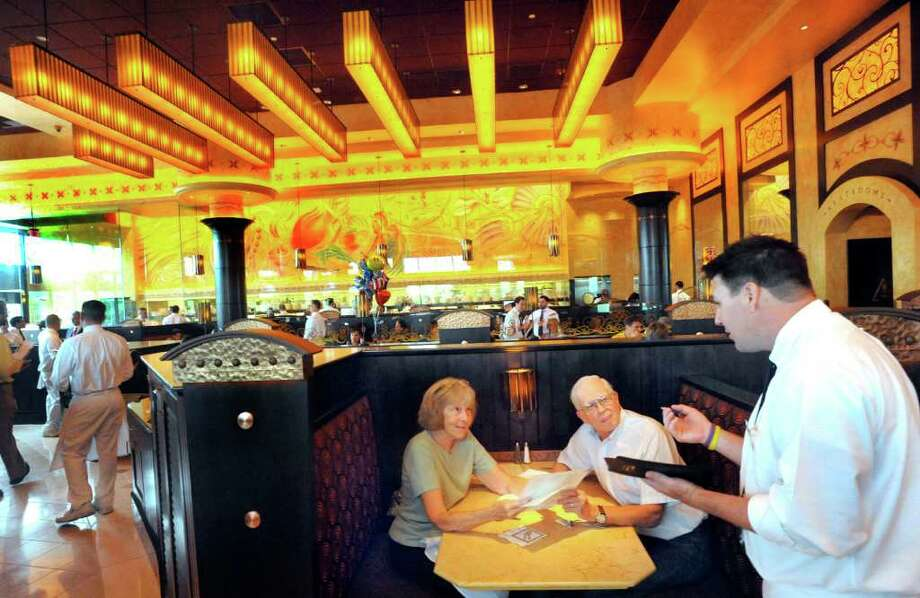 Gladys and Bill Ivansco, of Danbury, give their lunch order to waiter James Orme at the new Cheesecake Factory at the Danbury Fair mall Wednesday, Aug. 25, 2011. Photo: Michael Duffy / The News-Times