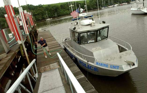 Bridgeport Police Officer Mike Killian fuels up the department's marine unit to be prepared for approaching Hurricane Irene at Captain's Cove Seaport in Bridgeport, Conn. on Thursday August 25, 2011. Photo: Christian Abraham