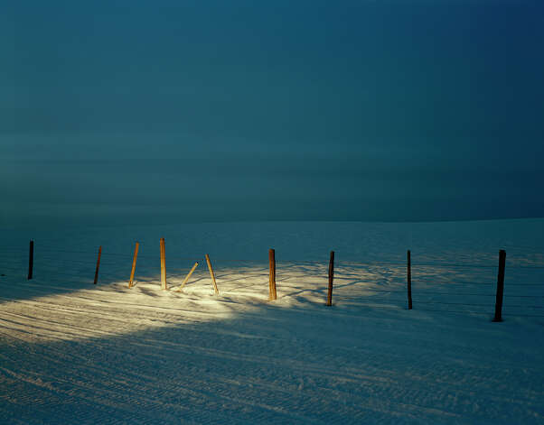 """Snowmobile Headlights, Valley Road, Custer County, Idaho,"" 2004 PHOTO COURTESY LAURA McPHEE"