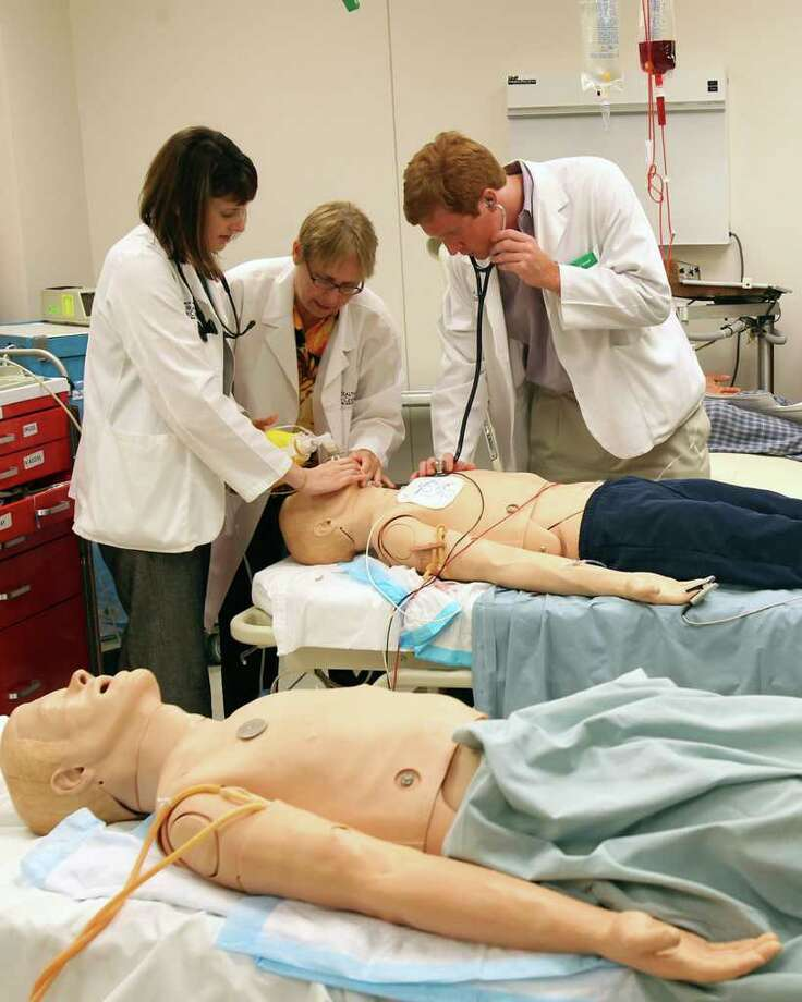 Dr. Patricia Wathen instructs third year medical students Jessica Reed and Edward Shipper in a simulated trauma case at the UT Health Science Center. Photo: TOM REEL, SAN ANTONIO EXPRESS-NEWS / © 2011 San Antonio Express-News