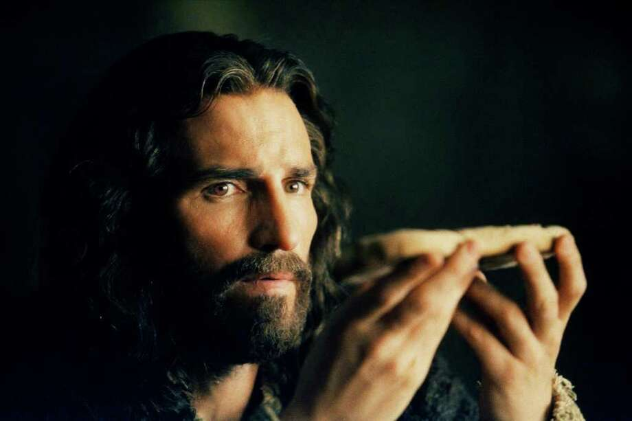 "Jim Caviezel as Jesus in The Passion Recut. A Newmarket Films release © 2004.  HOUCHRON CAPTION (03/11/2005) SECNEWS COLORFRONT:   Retooling ""The Passion"" Less gory rerelease is still too intense to garner a PG-13 rating.  HOUCHRON CAPTION (03/11/2005) SECSTAR COLORFRONT:   UNRATED: Jim Caviezel portrays Christ in The Passion Recut, which will be shown at seven area theaters. / handout"