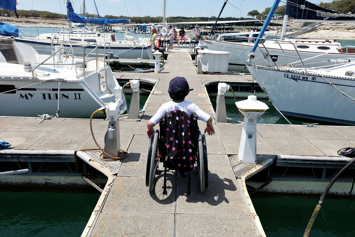 Kurt Wilkinson, 14, leaves the Lake Canyon Yacht Club dock after the Door in the Wall's adapted sailng event. EDWARD A. ORNELAS / EXPRESS-NEWS