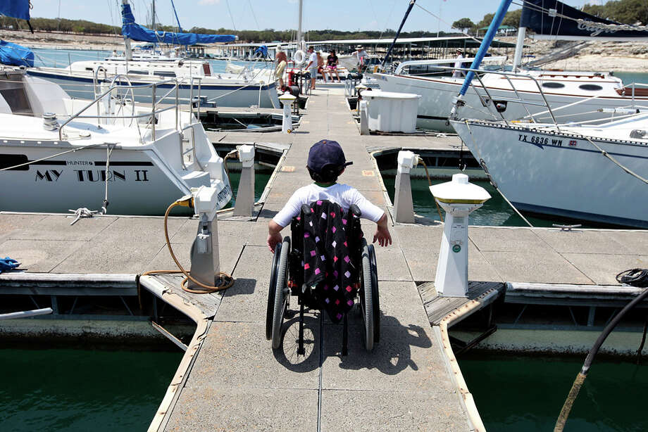Kurt Wilkinson, 14, leaves the Lake Canyon Yacht Club dock after the Door in the Wall's adapted sailng event. EDWARD A. ORNELAS / EXPRESS-NEWS / © SAN ANTONIO EXPRESS-NEWS (NFS)