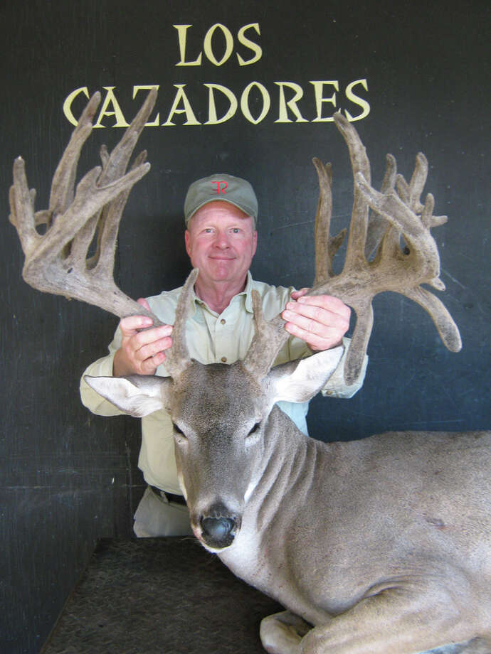 Mark Barrett of San Antonio displays his record-breaking buck, which will be on display with 300-400 whitetail mounts during the Texas Hunting & Outdoor Classic. COURTESY PHOTO