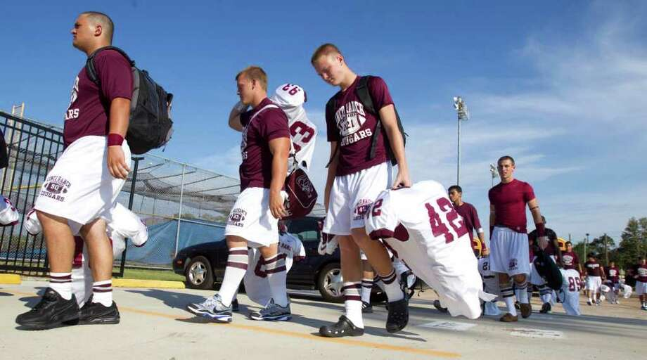 Cinco Ranch players arrive at Klein Memorial Stadium. Photo: Brett Coomer, Houston Chronicle / © 2011 Houston Chronicle