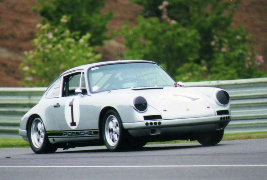 Greenwich's Roger Werner drives his 1965 Porche 911 at Lime Rock Park in Lakeville last week. Photo: Contributed Photo