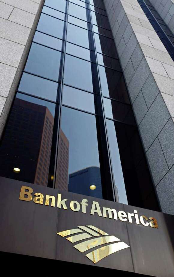FILE - In this file photo taken Oct. 8, 2010, the Bank of America building is shown at the Bank of America Plaza in downtown Los Angeles. Warren Buffett's Berkshire Hathaway is investing $5 billion in Bank of America Thursday, Aug. 25, 2011, sending its shares soaring by 24 percent.(AP Photo/Richard Vogel, File) Photo: Richard Vogel
