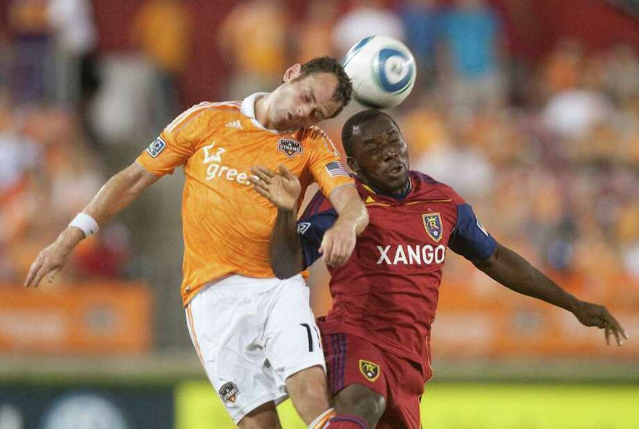 Houston Dynamo midfielder Brad Davis, left, heads the ball against Real Salt Lake midfielder Jean Alexandre during the second half of an MLS soccer game in Houston on Saturday, Aug. 20, 2011. (AP Photo/Patric Schneider) Photo: Patric Schneider, FRE / AP