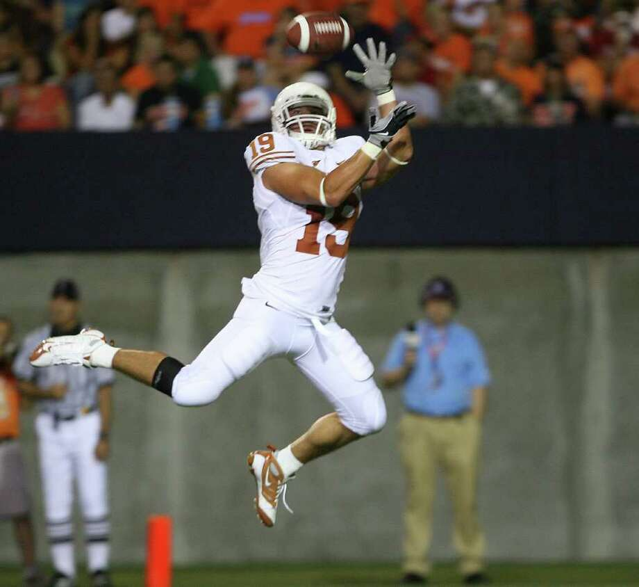 Texas receiver Blaine Irby catches a touchdown pass during the second quarter of their NCAA college football game Saturday Sept. 6, 2008 at the Sun Bowl Stadium in El Paso, Texas. (AP Photo/Victor Calzada) Photo: Victor Calzada, FRE / FR39270AP