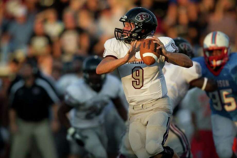 Pearland quarterback Jacob Garner looks for a receiver against Madison. Photo: Smiley N. Pool, Houston Chronicle / © 2011  Houston Chronicle