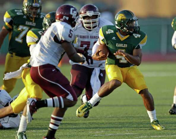 Klein Forest quarterback Matt Davis cuts back against the Cinco Ranch defense. Photo: Brett Coomer, Houston Chronicle / © 2011 Houston Chronicle