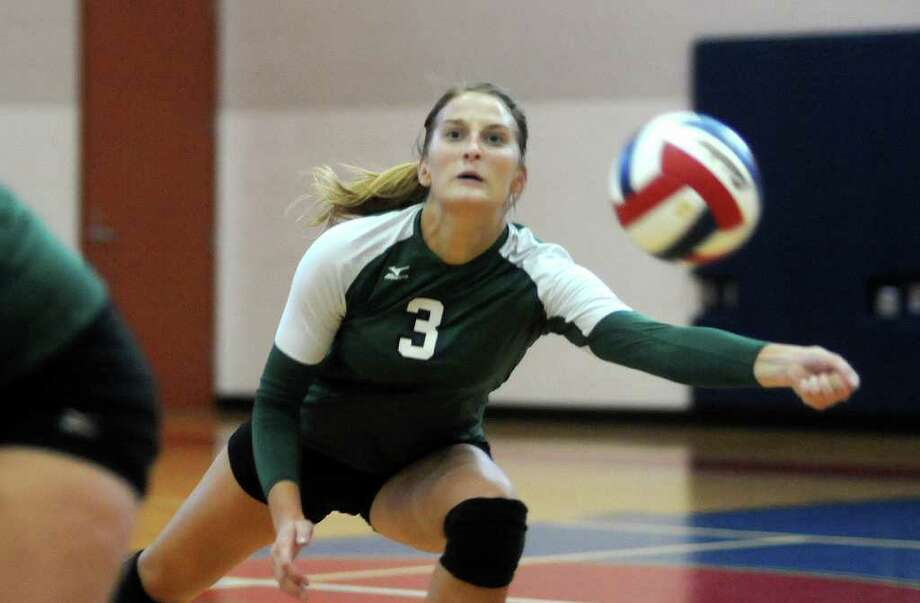 Brenham's Kelsey Weynand stretches to reach a ball against The Woodlands. Photo: Jerry Baker, For The Chronicle