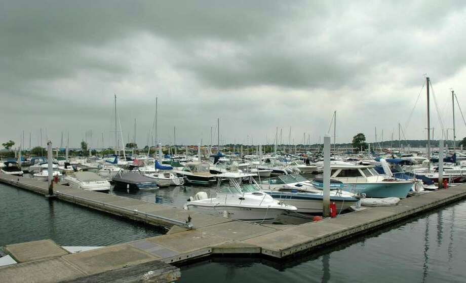 Storm clouds gather over Ned Dimes Marina at Compo Beach in Westport, Conn. on Thursday Aug. 25, 2011. Hurricanr Irene is expected to effect the area weather over the weekend. Photo: Cathy Zuraw / Connecticut Post