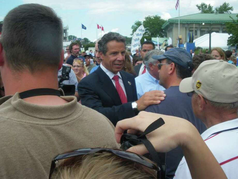 CUOMO GREETS FAIRGOERS: Gov. Andrew Cuomo greets people at the New York State Fair in Geddes, New York. It opened Thursday. (Jimmy Vielkind/Times Union)