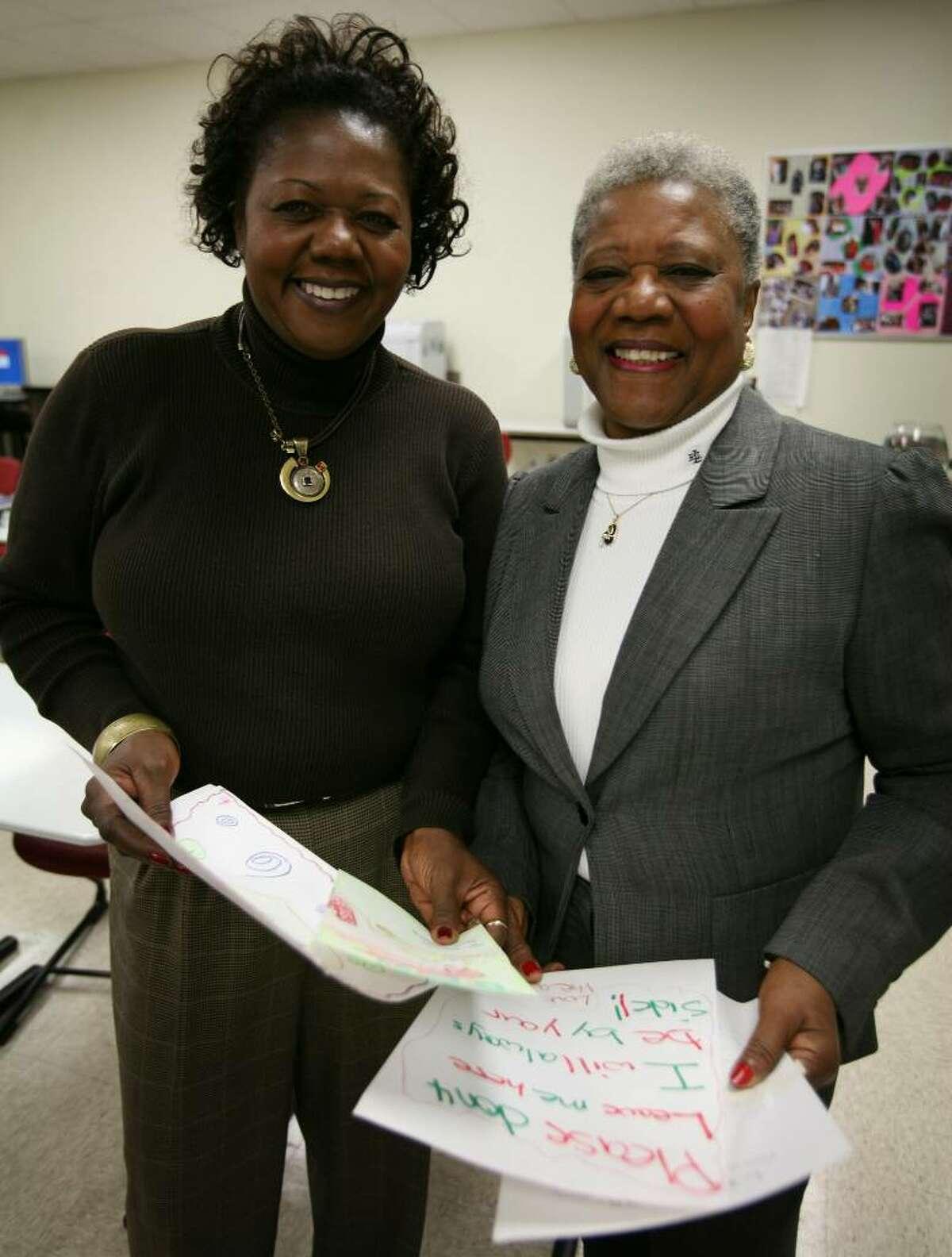 Assistant Supt. of Schools Denise Clemons, left and her mother Barbara Clemons recently participated in a door-to-door