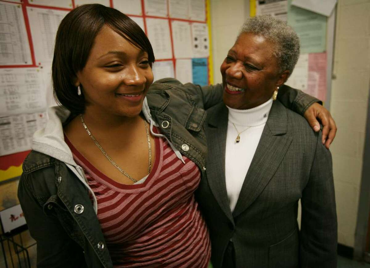 Barbara Clemons, right, gets a hug from her former student, Rachael Ragsdale-Hewitt, 16, during a visit to Central High School in Bridgeport, Conn. on Thursday, October 15, 2009. Clemons said Ragsdale-Hewitt, who was a difficult student when she was young, but was inspired by Clemons and has developed into a top student at Centrail High School.