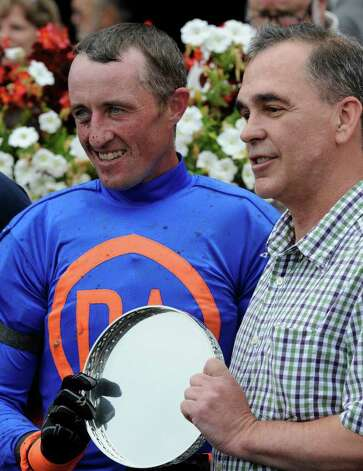 Race winning jockey Robert Walsh, receives the winner's trophy with trainer David Jacobson after horse Mabou won the 70th running of The New York Turf Writers Cup at the Saratoga Race Course in Saratoga Springs, N.Y.  Aug 25, 2011. (Skip Dickstein / Times Union) Photo: SKIP DICKSTEIN