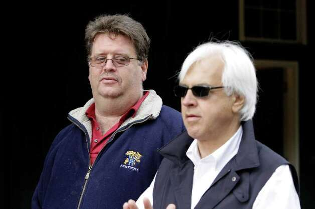 Trainers Dale Romans, left, and Bob Baffert talk outside the Stakes Barn at Pimlico Race Course in Baltimore on Thursday, May 19, 2011.  Romans trains Preakness entrant Shackleford while Baffert trains Midnight Interlude, both set to run in the 136th Preakness Stakes horse race on Saturday. (AP Photo/Garry Jones) Photo: Garry Jones / AP