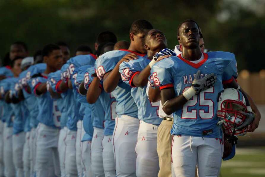 Madison players line up behind Joshua Rogers (25) during the national anthem before facing Pearland.