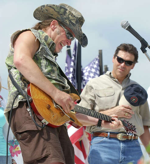 Ted Nugent plays an ear-splitting version of the Star Spangled Banner as Texas Gov. Rick Perry li