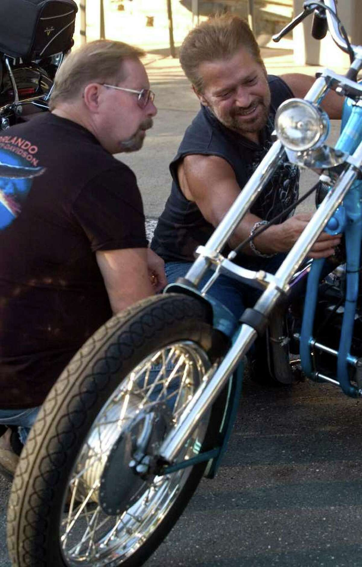 Ralph Gagliardi, of Trumbull, right, shows Norb Setzler, of New Fairfield, his 1964 Sportster during the weekly bike night at Hideaway Cafe on state Route 25 in Newtown on Tuesday, Aug. 23, 2011.