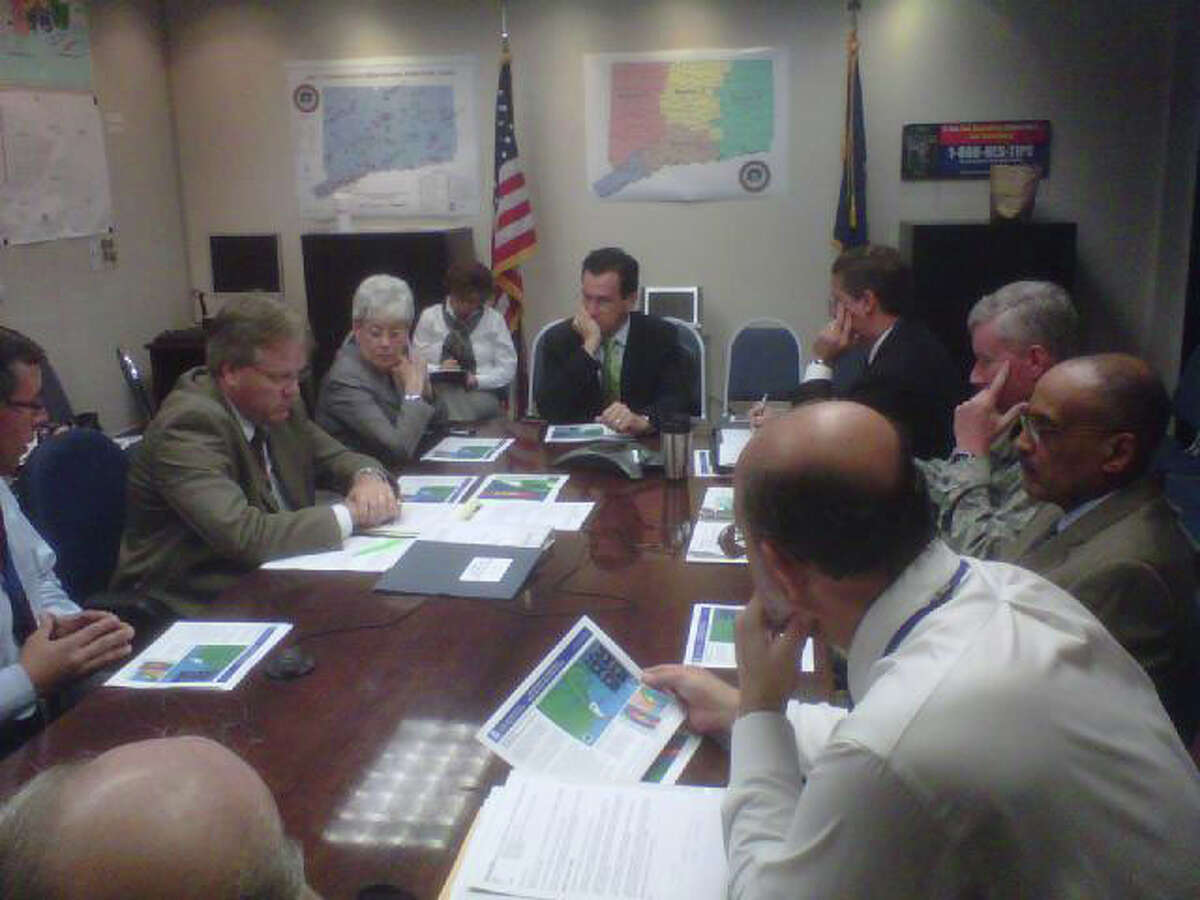 In a photo provided by Gov. Dannel P. Malloy's office, the governor and Lt. Gov. Nancy Wyman meet with his advisors in advance of Hurricane Irene the morning of Thursday, Aug. 25, 2011.