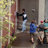 """Actor Bradley Cooper is pictured entering the Schenectady Police Dept. during filming for """"A Place Beyond the Pines,"""" Tuesday Aug. 23, 2011. (Courtesy www.FredrickCheesecake.com)"""