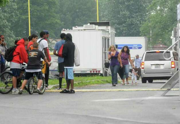 "Students gather in the parking lot as the movie ""The Place Beyond the Pines"" is being filmed at Schenectady High School on Wednesday, Aug. 24, 2011. ( Michael P. Farrell/Times Union) Photo: Michael P. Farrell"