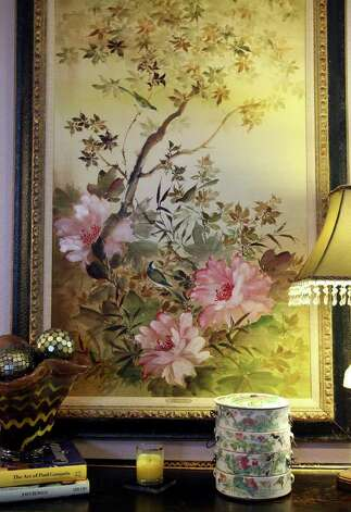 The home's design allows the couple to showcase their heirlooms and art pieces. In the living room, a Chinese lunch box complements an equally elegant painting. Photo: EDWARD A. ORNELAS, SAN ANTONIO EXPRESS-NEWS / © SAN ANTONIO EXPRESS-NEWS (NFS)