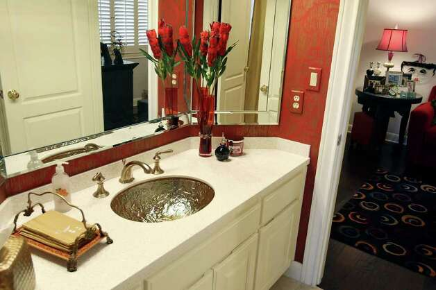 The guest bathroom features a textured sink. Photo: EDWARD A. ORNELAS, SAN ANTONIO EXPRESS-NEWS / © SAN ANTONIO EXPRESS-NEWS (NFS)