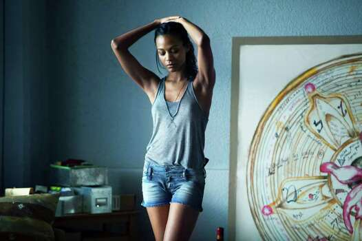 """In this film image released by Columbia Pictures, Zoe Saldana portrays Cataleya in a scene from """"Colombiana."""" (AP Photo/Columbia Pictures- Sony, Magali Bragard) Photo: Magali Bragard"""