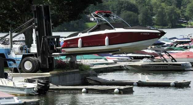 A boat is taken out of the water at the Candlewood East Marina in Brookfield in preparation for this weekend's predicted hurricane  Photo taken Friday, August 26, 2011. Photo: Carol Kaliff