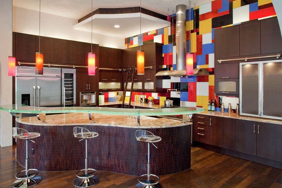 A bold backsplash in a Hill Country Village kitchen designed by Jennifer Hissa borrows from Piet Mondrian's geometric patterns exectued in primary colors. COURTESY PHOTO