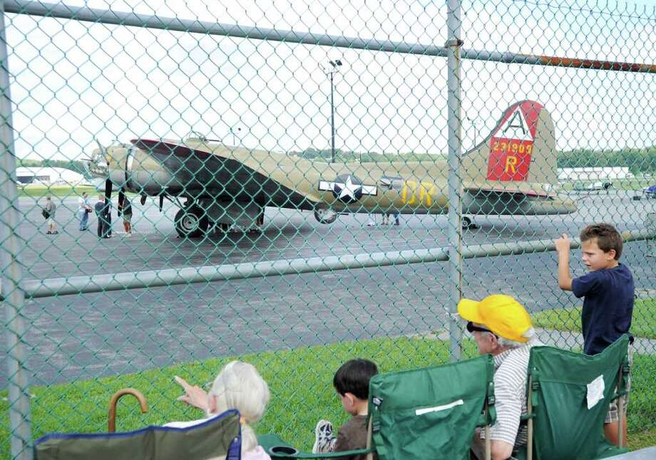 At right, Logan Gabriel, 6, of Somers, N.Y., gets a look at a B-17 Flying Fortress during the annual World War II bomber traveling exhibition at Westchester County Airport, White Plains in N.Y., Friday afternoon, Aug. 26, 2011. Photo: Bob Luckey / Greenwich Time