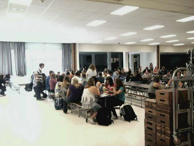 "Students wait on Friday, Aug. 26, 2011, in the Schenectady High School cafeteria between takes of the movie ""The Place Beyond the Pines."" (Paul Nelson/Times Union)"